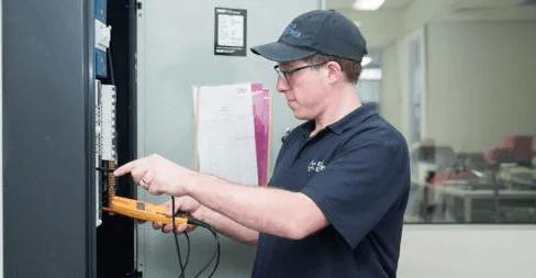 Ezra the electrician fixing an electrical fault